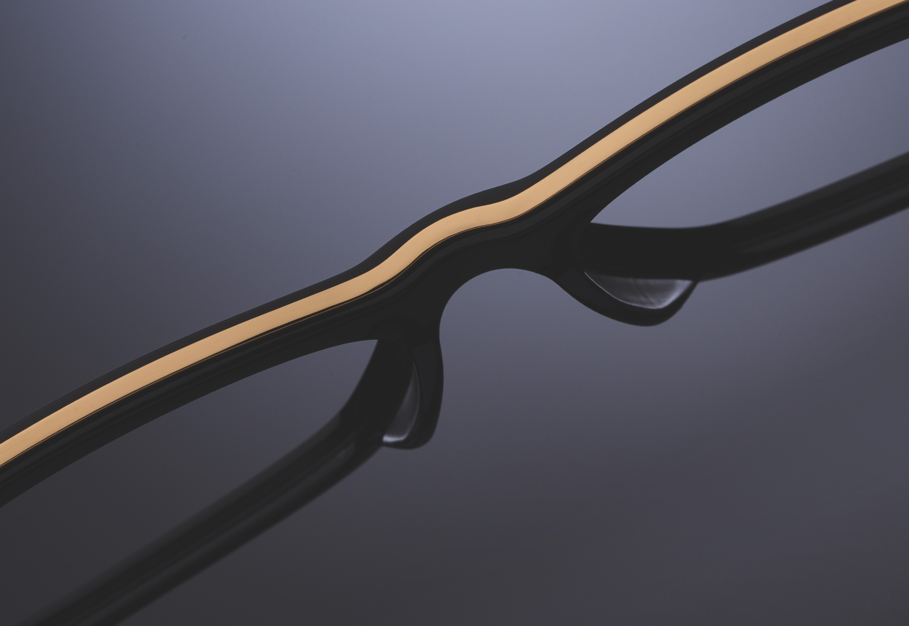 THIN TITANIUM INLAY EXTENDS THE ENTIRE LENGTH OF THE FRAME